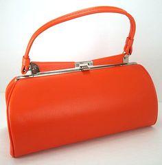 Vintage Tangerine Orange Large Single Handle Textured Vinyl Handbag. $24.00, via Etsy.
