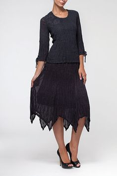 The movement of this skirt would be fantastic on a spring day and into summer.   A25131-charcoal(blouse)-+-A25132-charcoal-(skirt)