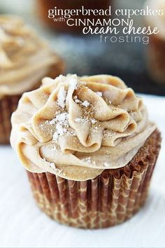 Gingerbread Cupcakes with Cinnamon Cream Cheese Frosting - I'll take a White Chocolate Snowflake with that ;) More