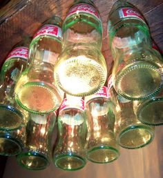 29 Recycled Bottle Lighting Designs-would like to try with amber beer bottles.