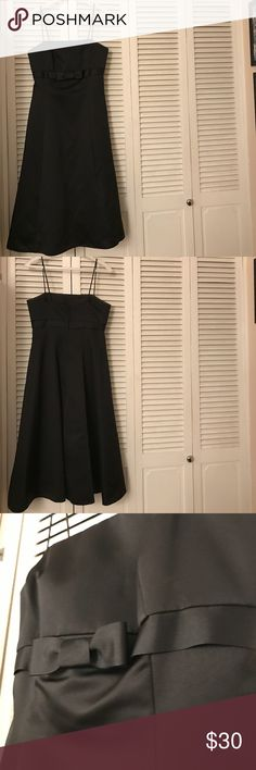 Black Formal dress Black bridesmaid dress that can be worn for prom, school dances, etc. it's one of those rare bridesmaids dresses that was actually worn more than once because it's so cute - it was worn twice.  David's Bridal, size six. Has a little puff at the bottom. Bow hits just below breasts. In near perfect condition, has some makeup rub off on inside front, but nothing can be seen when worn & rest of the dress is perfect. Nice sturdy fabric. Smoke and pet free home. David's Bridal…