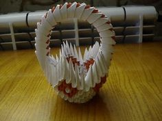 A tutorial showing you how to make a origami basket How to make the pieces check the tutorial in my channel Origami Egg, Origami Paper Folding, Paper Crafts Origami, 3d Tutorial, Origami Tutorial, Loose Waves Hair Tutorial, Origami Videos, Pinecone Ornaments, Origami Flowers