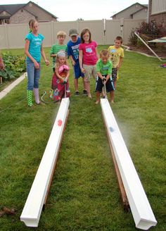 Duck racing with water blasters! (And lots of other great backyard carnival games!)