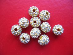 This is a set of 10 dazzling swarovski rhinestone filigree gold round beads. These beads measure 8mm in diameter and have 1.5mm hole through the
