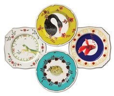 Plates designed by Lou Rota forAnthropologie. A black swan, a porcupine fish, a praying mantis and a Japanese fighting fish.