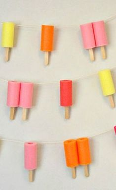 DIY JUMBO POPSICLE GARLAND ~ Made using pool noodles... Great for any outdoor Summer celebration or party