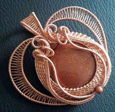 Stunning golden sandstone woven and wrapped in #copper in the delicate shape of a heart for valentines day. This #pendant measures approximately 2 1/2 by 2 3/4 inches in size. #jewelry #wirewrappped #wiresculpted #artisangift #mothersday #handmade #womens #ooak