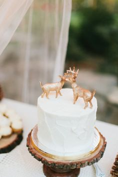 #cake-toppers  Photography: Wai Reyes - waiphoto.com  Read More: http://www.stylemepretty.com/california-weddings/2014/12/24/rustic-romantic-wrightwood-ranch-wedding/