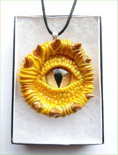 Items similar to Bold yellow and gold dragon eye pendant, handmade from polymer clay featuring a painted glass cabochon on Etsy Gold Dragon, Dragon Eye, Human Body Parts, Eye Jewelry, Fairy Doors, Project Ideas, Projects, Air Dry Clay, Art Classroom