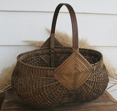 Large Woven Splint Buttocks Basket by PastClassics on Etsy https://www.etsy.com/listing/213311450/large-woven-splint-buttocks-basket