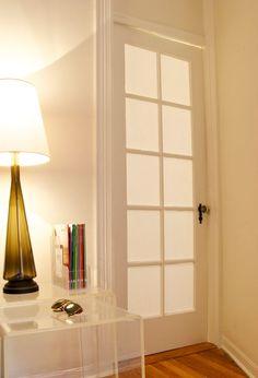 Glass doors made opaque using just fabric and cornstarch. From Manhattan Nest Blog: http://manhattan-nest.com/2010/06/01/the-doors/