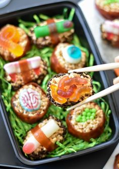 Gross out your family and friend with these creepy Halloween Candy Sushi--the sweet and disgusting version of your favorite takeout!
