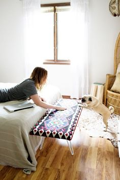 Upholster a piece of wood with a pretty blanket (and hairpin legs, again) for a colorful bench. | 33 Gorgeous DIY Projects To Decorate Your Grown Up Apartment
