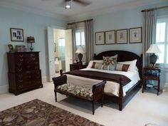 Traditional Guest Bedroom with Carpet, Paula deen home 7 drawer chest - tobacco, Concrete tile , Crown molding, Ceiling fan