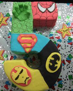 Superhero cake @Denise H. H. Watts - shape and incorp of the superheroes