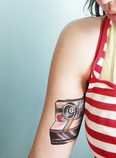 I love this.  I really want a tattoo of a camera, not necessarily a Polaroid though.