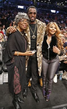 Camera ready: Diddy posed for pictures with Voletta and rapper pal Lil' Kim...