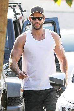 Liam Hemsworth flaunts rippling muscles in tight white vest top Liam Hemsworth flaunts rippling muscles as he meets Gabriella Brooks for lunch date Liam Hemsworth, Hemsworth Brothers, Magazine Man, Fitness Magazine, White Vest Top, New Girlfriend, Play Soccer, Bearded Men, Bad Boys