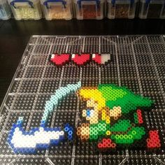 Mostly finished with this Link. Looks like he needs to smash some pottery to get his health back #perlerart #zeldaperler by tyler_maff