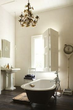The chair, the shutters, black bathtub, and the old scale!