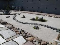 Small japanese garden with natural stone in Juuka, Finland.