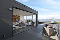 living room and penthouse deck with views of TransAmerica Building and Coit Tower, San Francisco