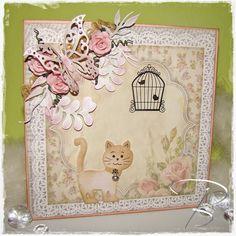 """Wachsames Kätzchen 1201/0001 Joy!Crafts Stanz- und Prägeschablone (Katze) 6002/0263 Joy!Crafts Stanz- und Prägeschablone """"Billes Flourishes"""" Joy!Crafts Stanzschablonen: 6003/0023 (Schmetterling) + 6003/0035 (Blätter) 6011/0701 Joy!Crafts Unikarton 6011/0206 Joy!Crafts Paper bloc 6350/0024 Joy!Crafts Gems&Jewels 6350/0102 Joy!Crafts Metal Charms 6300/0325 Joy!Crafts Band 6410/1001 Joy!Crafts Stempelfarbe 6370/0053 Joy!Crafts Flowers 6200/0205 Joy!Crafts Chalks Viele Bastelgrüße Bille"""