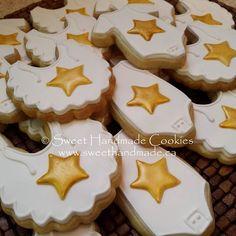 Twinkle, twinkle little star onesie and bib cookies.  #sweethandmadecookies #customcookies #decoratedcookies #designercookies #cookies #bradfordontariocookies #babyshowercookies #twinkletwinklelittlestar