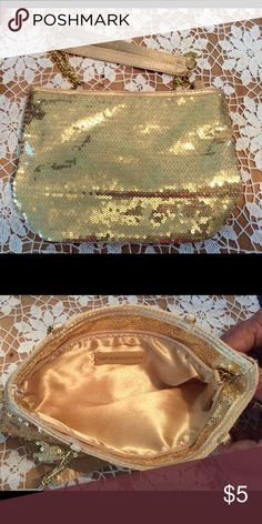 Glittery make-up bag Make-up bag from Bath & Body Works - never used.   Can be used as a wristlet, too, as it does have handles.  Very sparkly and cute!  Would be appropriate for a little girl, too! Bath & Body Works Bags Cosmetic Bags & Cases