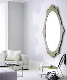 The 3 rules of painting your walls gray: 1. Use flat paint. 2. Opt for a creamy trim. 3. Introduce lots of light sources.
