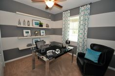 Soothing gray and striped wall accents makes any office more fun to work in! Lennar Homes in Harmony, FL