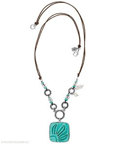 "True style is carved in stone with this Sterling Silver, Howlite, Pearl and Glass Necklace. Approximately 20""."