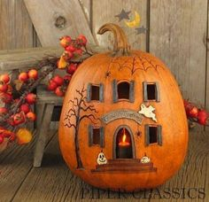 Halloween pumpkin carved as a spooky house, with small electric candle inside. Available to buy from piper classics Halloween carving Theme Halloween, Holidays Halloween, Halloween Pumpkins, Halloween Crafts, Happy Halloween, Halloween House, Halloween 2018, Halloween Magic, Haunted Halloween