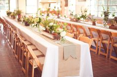 Nature inspired tablescapes with potted plants, wooden crates and tea lights | Photo: Papered Heart Photography