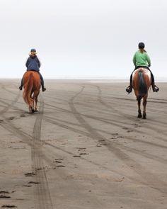 Horseback riding on the beach in Ocean Shores, Washington.