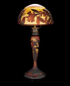 Daum Frères (1878-), A Table Lamp cameo glass acid-etched with a floral design, brown and red overlay against an internally mottled yellow ground