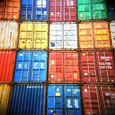 Color picture of stacked shipping containers. This picture is made with a Holga GTLR 120 on Kodak Portra The picture is printed with a Lambda