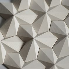 http://ift.tt/OHgbym White concrete tiles. They are based on an origami pattern folded from one sheet of paper.
