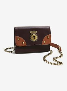 """Keep all of your magical items in this adorable crossbody bag. Designed after Newt Scamander's magical suitcase; its """"Muggle Worthy"""" snap closure will keep all of your secrets safe. Interior drop and zip pockets. Wholesale Handbags, Handbags On Sale, Purses And Handbags, Cute Harry Potter, Harry Potter Outfits, Backpack Purse, Crossbody Bag, Nerd Merch, Popular Purses"""