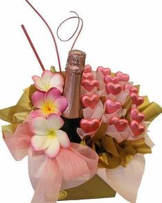 What a great idea!  Flowers, Champagne and Chocolate in one centerpiece