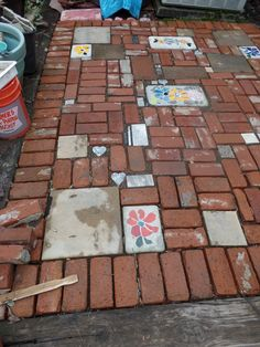 Patio 2016, nearly finished..Made with recycled brick and pavers and homemade mosaic/cement pavers..Diane Erickson