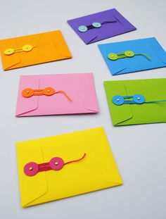 How to make string-tie envelopes from any paper you want (use newspaper or brown paper bags to suck up to Captain Planet).