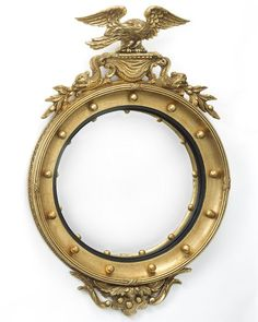 The Federalist Designs - and composition round girandole convex mirror with eagle, dolphins and additional applied decoration. Shown with black inner edge in standard antiqued gold metal leaf finish. Convex Mirror, Vintage Mirrors, Condo Living, Gold Gilding, Round Mirrors, Antique Gold, Wall Sconces, Eagle, Carving