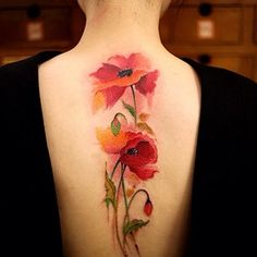 Brightly colored poppies. Watercolor look, red flower tattoo. Beautiful! | 32 Cool And Colorful Tattoos That Will Inspire You To Get Inked