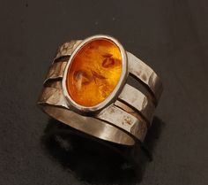 A craft style sterling silver ring with a hammer finish and set with a great piece of amber!