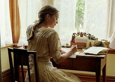 Writing at her desk