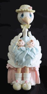 If you are having twins you need this adorable Stork With Twin Babies Cake Topper.