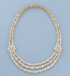 A FINE DIAMOND NECKLACE, MOUNTED BY VAN CLEEF & ARPELS   The front designed as three rows of old-cut diamonds alternating with smaller brilliant-cut diamonds to the cluster terminals and diamond twin line necklace, circa 1960, 39.9 cm. long, with French assay mark for gold, in Van Cleef & Arpels blue suede fitted case  Signed Van Cleef & Arpels, No. M38007