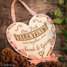Our First Valentines Together Valentine Day Engraved Hanging Decoration Gift. Painted in an authentic period colour and engraved into the surface of the oak veneer with a gingham ribbon laced through the heart to frame it.