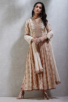 RITU KUMAR Featuring a ecru colored flared kurta in cotton viscose and georgette base with embroidery, print, full sleeves and band collar. It is paired with matching leggings and dupatta. Anarkali Kurti, Churidar, Ethnic Suit, Ritu Kumar, Kurti Collection, Indian Fashion Designers, Types Of Sleeves, Full Sleeves, Everyday Dresses